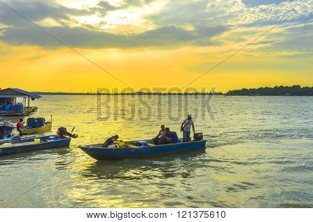 KLANG MALAYSIA - FEBRUARY 08 2016 : Traditioal wooden fisherman boats park at the jetty with sunset background