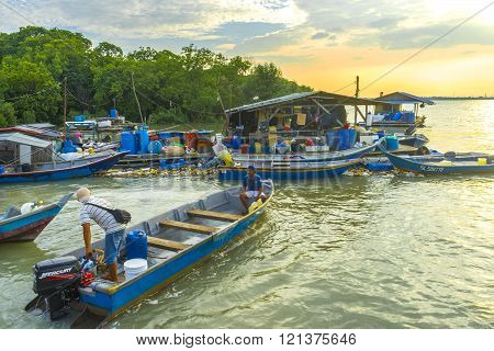 KLANG MALAYSIA - FEBRUARY 082016 : Traditioal wooden fisherman boats park at the jetty with sunset background