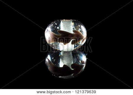 Clear brown glassy bead