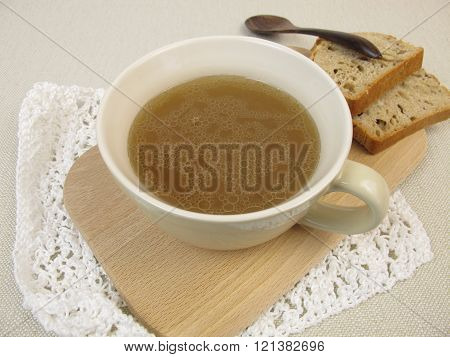 Cup of broth with bread