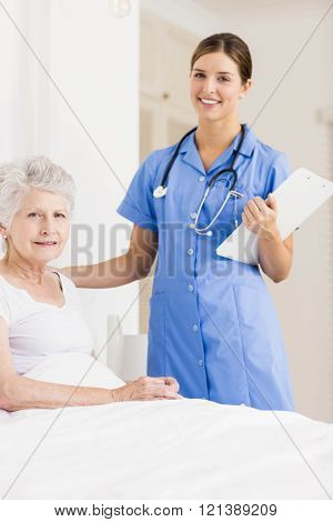 Doctor taking care of suffering senior patient at home