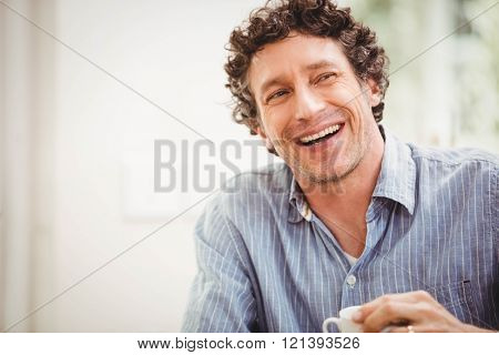 Portrait of mature man smiling at home