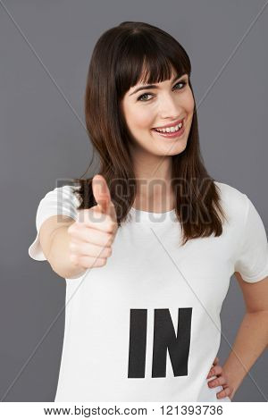 Young Woman Supporter Wearing T Shirt Printed With In Slogan