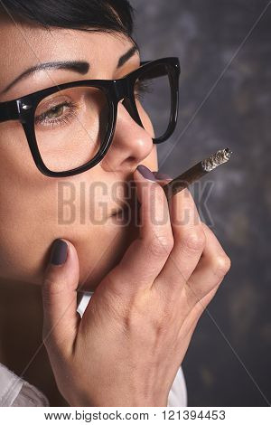 Young  Business Woman  In Glasses Smoking And Thinking, Mouthfulls