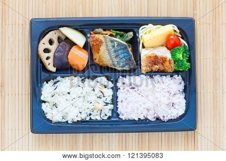 Bento Single portion takeout or home packed meal in Japanese cuision
