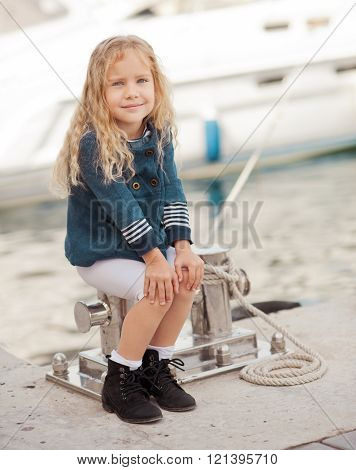 Stylish kid girl outdoors