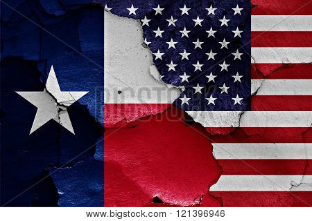 flags of Texas and USA painted on cracked wall