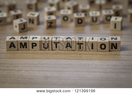 Amputation Written In Wooden Cubes