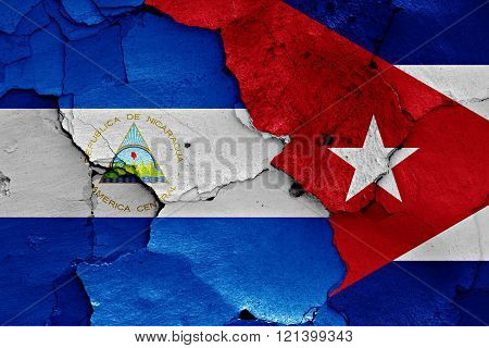 Flags Of Nicaragua And Cuba Painted On Cracked Wall