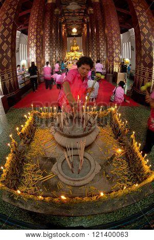 AYUTTHAYA,THAILAND-FEBRUARY 10,2010 : Thai Buddhist people is worship of Phra Phuttha Nimit Wichitmara Moli Sri Sanphet Boromatrailokanat that in a royal regalia -clad, about six feet high Buddha statue in the Ubosot at Wat Na Phra Meru . Located in Ayutt