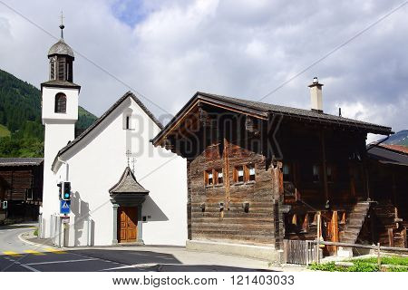 The ancient traditional chalet and Church along the Furkastrasse. Munster