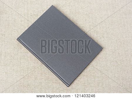 Grey book on the table