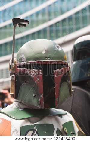 MILAN ITALY - MARCH 5: Boba Fett character of 501st Legion official costuming organization takes part in the Star Wars Parade wearing perfectly accurate costumes on MARCH 5 2016 in Milan.
