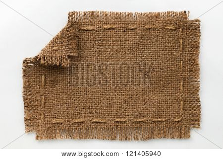 Frame Of Burlap With Curled Edges, Lies On A White Background