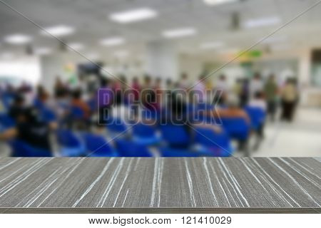 Empty Wooden Table With People Waiting To See Doctor In The Hospital Blur Background