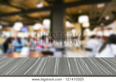 Empty Wooden Table With People Eating Food In Food Court Blur Background