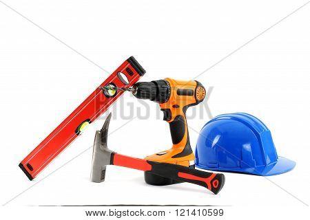 tools: drill hammer safety helmet,spirit level isolated white