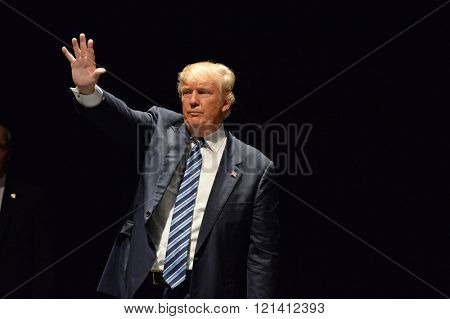 Saint Louis, MO, USA - March 11, 2016: Donald Trump salutes supporters at the Peabody Opera House in Downtown Saint Louis