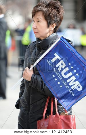 Saint Louis, MO, USA - March 11, 2016: Donald Trump supporter holds sign outside the Peabody Opera House in Downtown Saint Louis