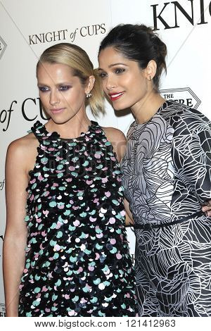LOS ANGELES - MAR 1: Teresa Palmer, Freida Pinto attends the Premiere of Broad Green Pictures' 'Knight of Cups'  at The Theatre at Ace Hotel on March 1, 2016 in Los Angeles, California