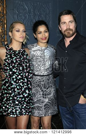 LOS ANGELES - MAR 1: Teresa Palmer, Freida Pinto, Christian Bale attends the Premiere of Broad Green Pictures' 'Knight of Cups'  at The Theatre at Ace Hotel on March 1, 2016 in Los Angeles, California