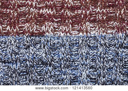 Blue white black brown red mixed knitted fabric made of heathered yarn textured background