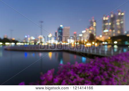 Night blurred bokeh lights, city view in Bangkok public park