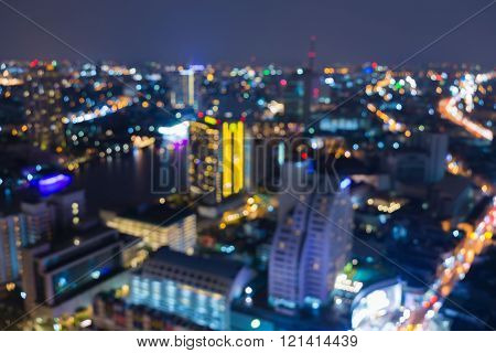 Night blurred bokeh light, aerial view city downtown, abstract background