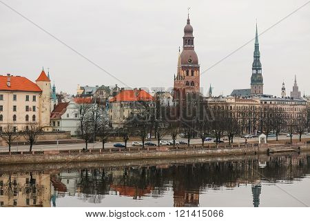 Riga Old Town panorama at dusk over Daugava river.