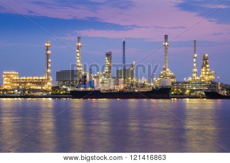 Twilight riverfront over Oil refinery