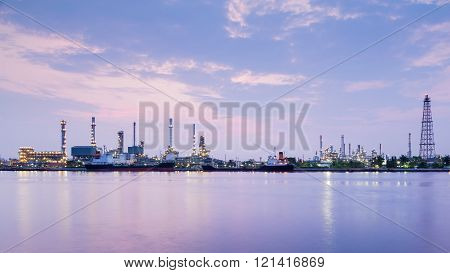 Twilight of panorama power chemical plant riverfront