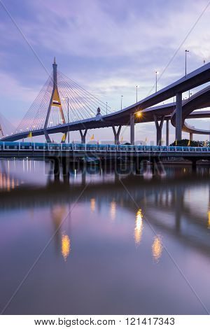 Suspension bridge river front and reflection ( Industrial Ring Road Bridge) in Bangkok Thailand