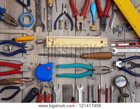 Tools On A Wooden Floor, Top View.