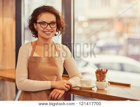 Pleasant woman standing in the cafe