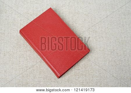 Red book on the sofa