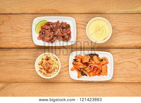 Two Seafood Octopus And Squid Salads On Wood