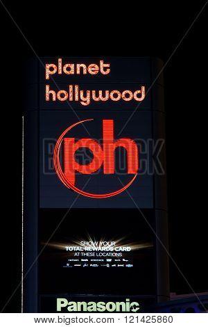 Planet Hollywood Sign And Logo At Night