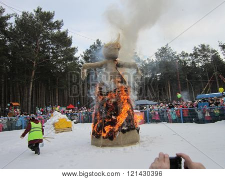 burning of an effigy of Maslenitsa on a holiday of a farewell to winter