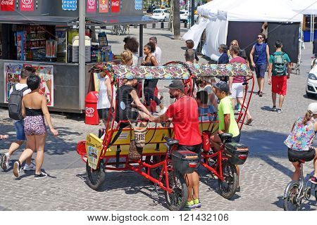 Two young men and rickshaw taxis in Barcelona