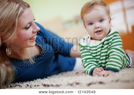 Mother with her baby at home