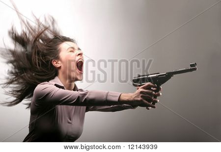 A woman screaming with a gun
