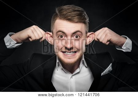 Man in suit makes funny face