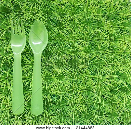 Green Background For A Picnic With Grass And A Fork And A Spoon