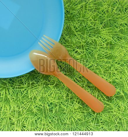 Fun Colored Background With Spoons, Forks , Dish On Green Grass #3