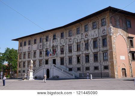 PISA, ITALY - JUNE 06, 2015: PISA, ITALY - JUNE 06, 2015: Building of Pisa Superiore University on Piazza dei Cavalieri (Palazzo della Carovana) decorated with frescos, in Pisa, Italy on June 06, 2015