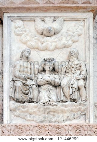 BOLOGNA, ITALY - JUNE 04: The Coronation of the Virgin by Giacomo Scilla, right door of San Petronio Basilica in Bologna, Italy, on June 04, 2015