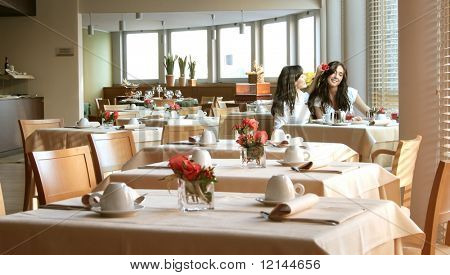 two girl in a breakfast room of hotel