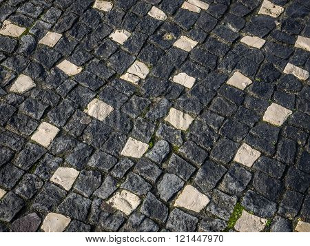 Close up of a black and white cobblestones on a street