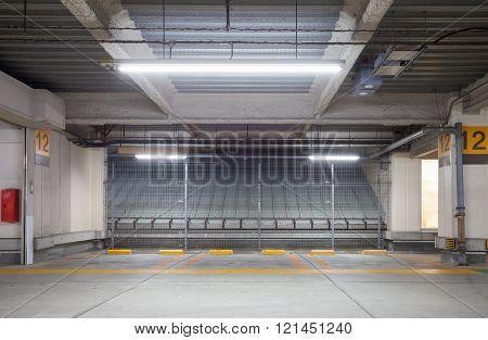 Parking garage underground interior neon lights at night