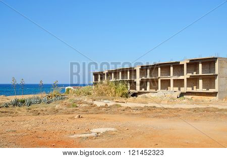 Unfinished building in Loutraki at sunny summer day Greece.